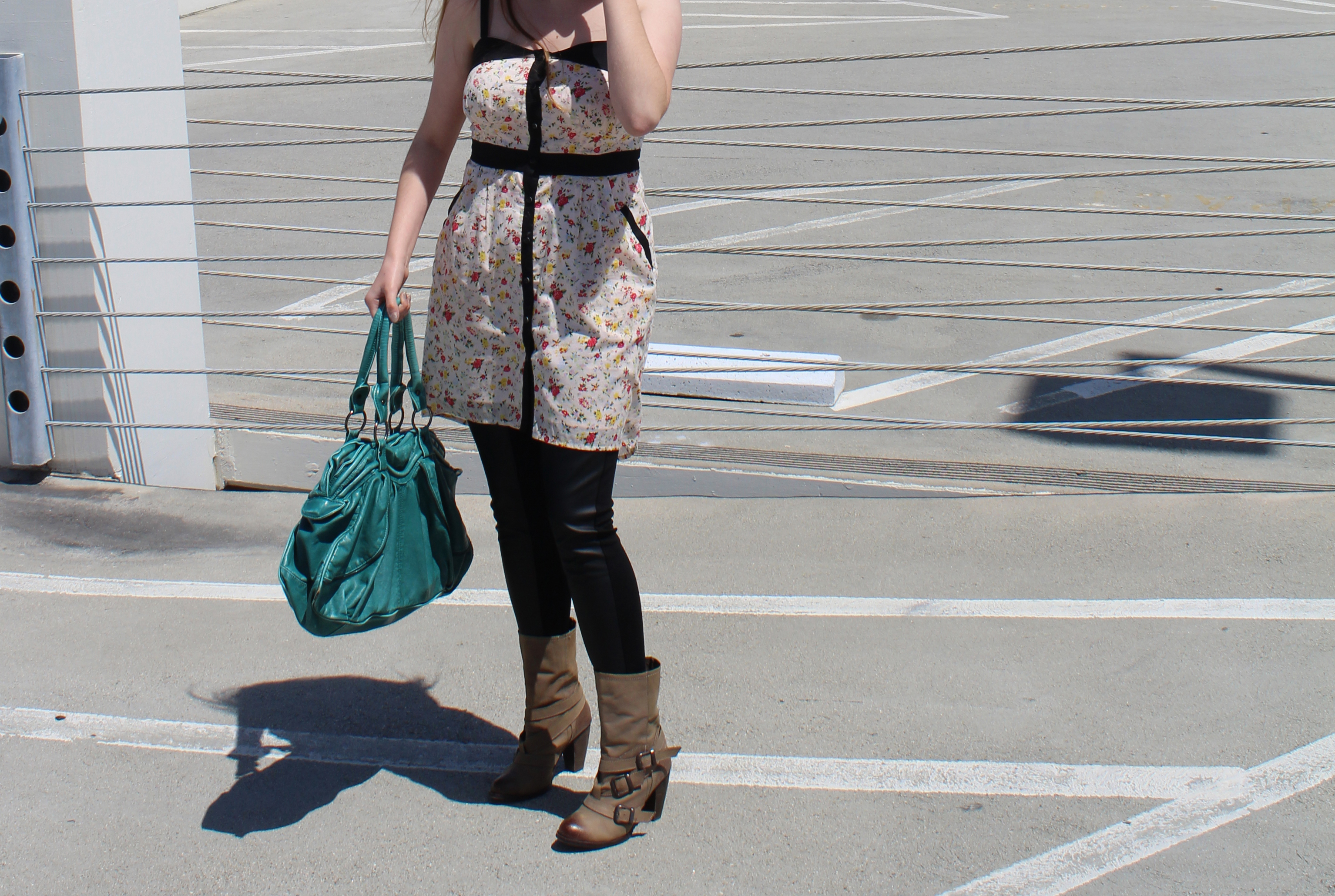 Floral dress by BCBGeneration, Vegan leather leggings from FACTORY by Erik Hart, boots by Steve Madden