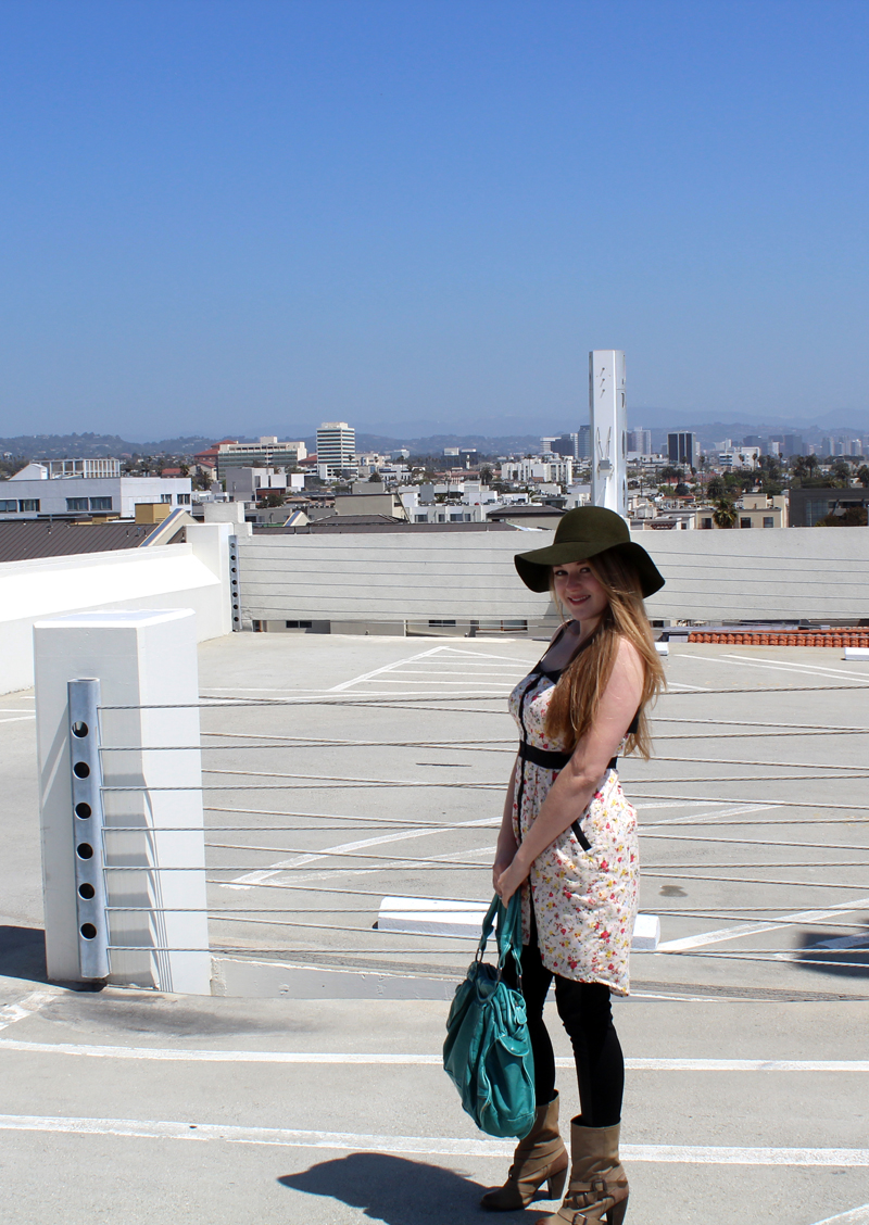 Floral dress by BCBGeneration, Vegan leather leggings from FACTORY by Erik Hart, hat by Tarnish