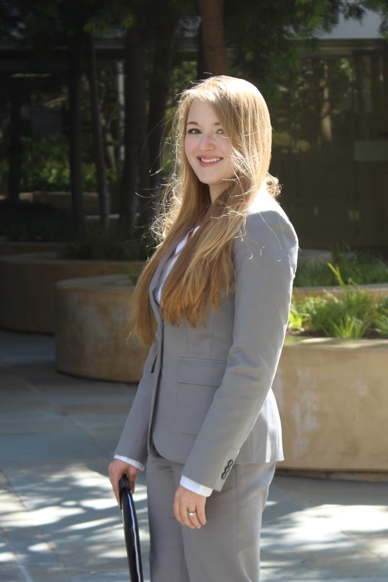 H&M blouse, Banana Republic suit, Office Depot portfolio