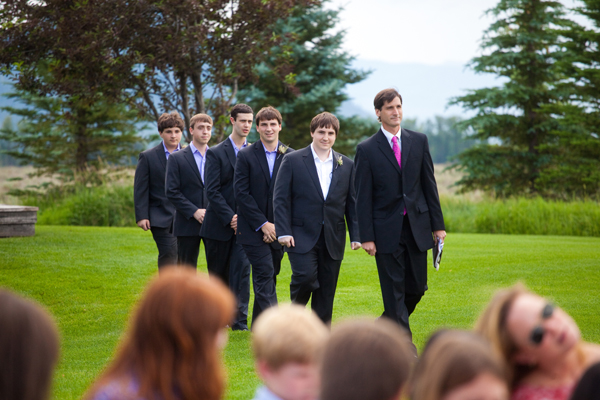 the officiant, the groom and the groomsmen