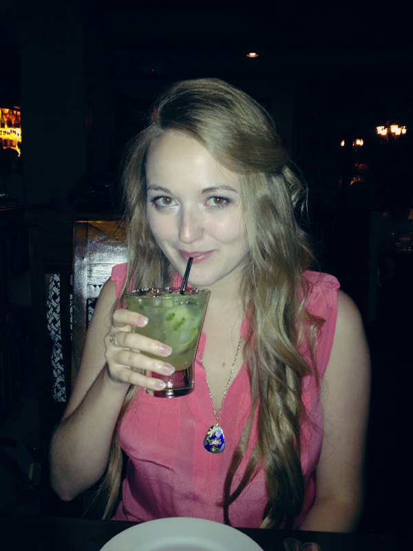 curled hair and a jalapeno margarita